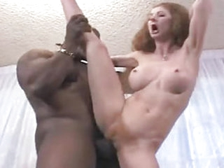 Her sucking of black cock is almost as crazy as her wild head of hair