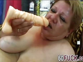 Chubby granny masturbates and rides dick