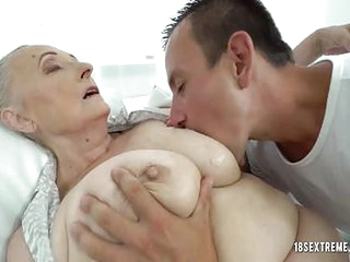 Granny enjoys getting fucked and having her massive juggs licked and pussy filled with young dick