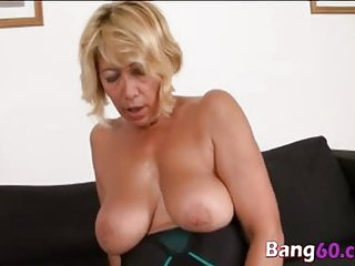 Busty blonde mommy fucking with a hard big black cock rocking her mature blonde bod