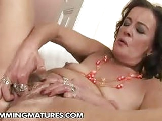 Granny takes on a humongous dildo and then gets fisted by a younger hot lesbian..