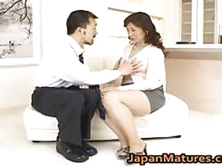 Mature chinese slut is getting fucked by a business man in her cunt..