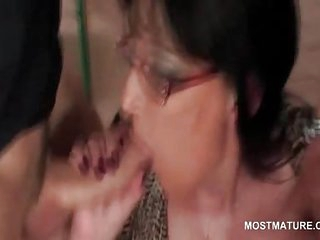 Mature tramp busy giving double blowjob