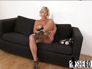 Granny Sarah masturbates and rides a most massive large black dong in her mature cunthole