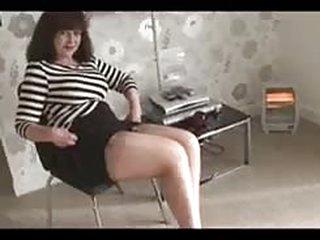 xxx video Big tits mature babe in mini dress strips