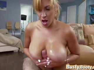 Blonde milf maid spraying cum on her big tits after jerking off a nice stiff cock with a nice handjob
